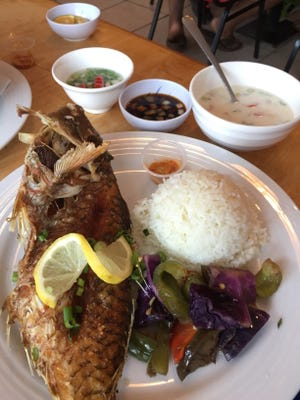 Fried parrot fish and rice at Ron's Diner.