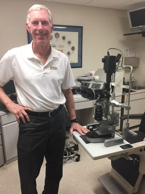 Dr. Frank Butler in his examination room at Naval Hospital Pensacola