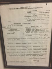 Judith Clark's commitment papers, signed in 1983, sent her to Bedford Hills Correctional Facility. Gov. Andrew Cuomo's decision in the waning hours of 2016 may open the door for her parole, decades before she would otherwise have been eligible. The document is on display at the Rockland County Sheriff's Department in New City.