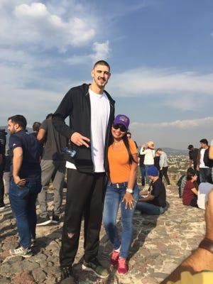 Suns center Alex Len with a fan in Mexico.