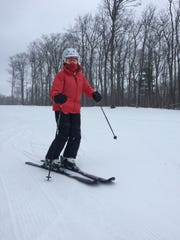 Terry Smith continues to ski and snowboard, serving on the ski patrol.