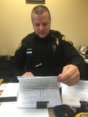 Deputy Chief Erik McKee and the documentation he has