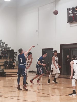 Owego's Christian Sage hits a free throw during the first quarter of a  Southern Tier Athletic Conference game last season at Johnson City. Sage is one of three Owego players who'll suit up for Southern Tier in the Summer Hoops Festival at JC.