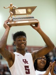 Tee Higgins is presented with a Mr. Football trophy