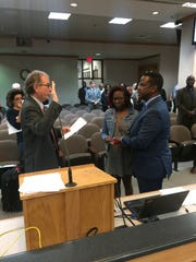 Louis Johnson has been sworn in as the interim commissioner