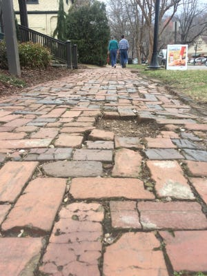 Many of the sidewalks in Biltmore Village are made of bricks, to fit the historic nature of the area. They are prone to unevenness and other problems, though.