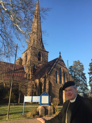 Rev.J. Connor Haynes stands in front of historic St. Mary's Episcopal Church in Burlington City. The church is one of four Burlington County sites to win a state grant for stone, brick and mortar restoration work.