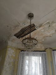 Ceiling damage in the parlor of White Hill Mansion needs repair, as does much of the house. Friends of White Hill, a group dedicated to preserving and restoring the historic home, offer tours of the mansion, often to paranormal tourists looking for evidence of ghosts and hauntings.