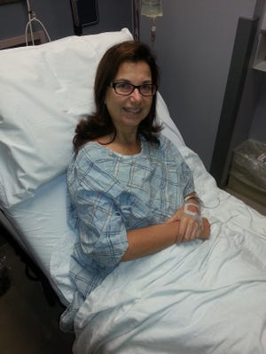 Linda Freeman is shown in her hospital bed before surgery for breast cancer.