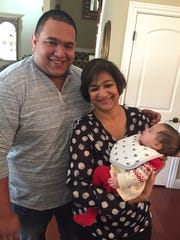 New addition Geeta and John Rodrigues welcomed their first grandchild with a celebration shower at their Sutherland home. The baby's parents, Stefanie and Stan Rodrigues, came in from Dallas for Sloan's first visit to Evansville.  John is the proprietor and Chef de Cuisine at Sixty Vines in Dallas. In the photo are Dad Stan with Grandmother Geeta and sleeping Sloan.