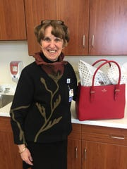 Deaconess President and CEO Linda White dropped off her Go Red handbag. The red Kate Spade tote is filled with a variety of fun clothing items including several scarves, a sweater, tights and a collection of Brighton accessories. It'll be up for auction during the luncheon.