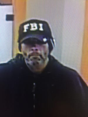 The FBI is requesting the help of the public to lead to the identification, arrest and conviction of a man believed to have robbed five banks. Here, he is in the Chase Bank in McMinnville, Oregon.