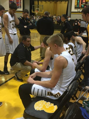 Northmor boys basketball coach Zach Ruth talks to his team during a second-half timeout against Lucas this season. Ruth was named Ohio Division III Boys Basketball Co-Coach of the Year by the Associated Press.