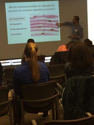 Sean Flynn explaining neurotransmitters role in muscle movement.