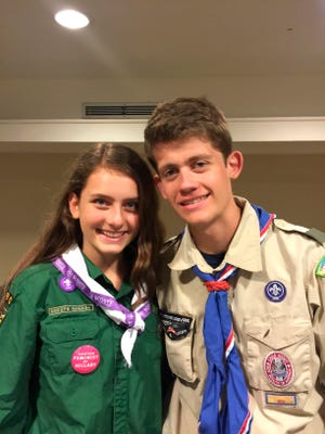This June 2016 provided by their father, Gary Ireland, shows 15-year-old Sydney Ireland, left, of New York, with her bother, Bryan, who is an Eagle Scout, at a National Organization for Women conference in Washington. For several years, Sydney has been an unofficial member of her brother's troop in Manhattan, participating in many of its activities but unable to earn merit badges to start on the path to Eagle rank.