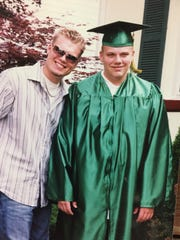 Colin Riebel, right, upon his graduation from Triton Regional High School in 2009, with his brother, Andrew. Colin died of a heroin overdose after getting addicted to painkillers following sports injuries.