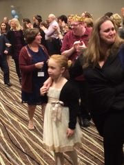 Guests enter a Night to Shine a special needs prom event to an ovation from 'paparazzi' on Friday night at Hotel Marshfield.
