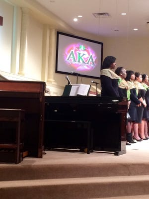 Alpha Kappa Alpha members rise during the 109th Founder's Day Program on Sunday at St. Paul CME Church.