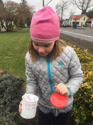"""Naomi Hamlin, 8, finds the prize. Those who bring a trinket can """"take one and leave one."""""""