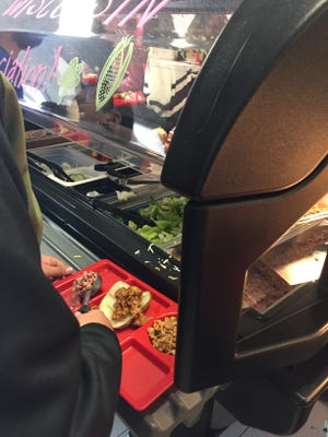 Students enjoy the variety of healthy toppings available to put on top of their baked Wisconsin Russet Burbank potatoes during lunch on February 22.