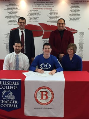 Bellevue's Alec Foos, center, announces he will continue his football career at Hillsdale College in Michigan. Foos is joined by brother, JJ Foos, front left, mother, Lisa Foos, father, Brian Foos, back left, and Redmen coach Ed Nasonti.