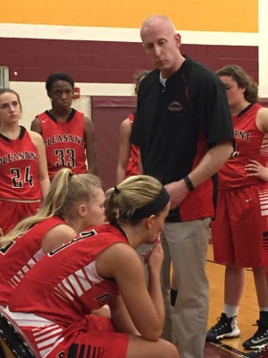 Pleasant girls basketball coach Nate Dendinger talks to his girls before pregame introductions Tuesday night at Westerville North. The Spartans won the Division III district semifinal game over Amanda-Clearcreek 57-50.
