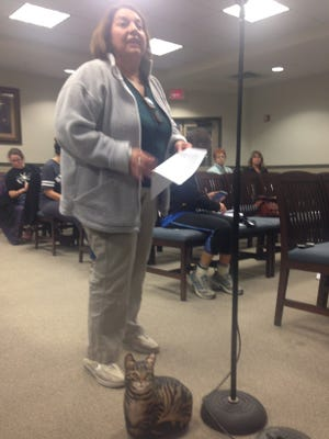 Hasbrouck Heights resident and former Councilwoman Sonya Buckman brought a cat doorstop as a prop at the meeting and spoke out against licensing of cats.