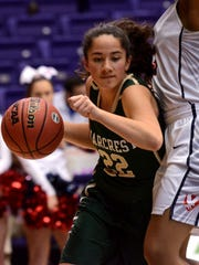 Briarcrest's Alex Tiatia (22) tries to get around a Brentwood Academy defender during Thursday's Division II-AA semifinal at Lipscomb's Allen Arena.