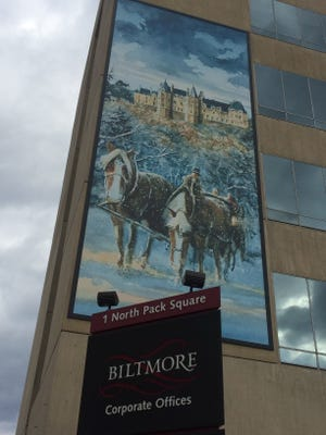 This large banner on the side of the Biltmore Estate company headquarters in downtown Asheville is legal, according to the city.