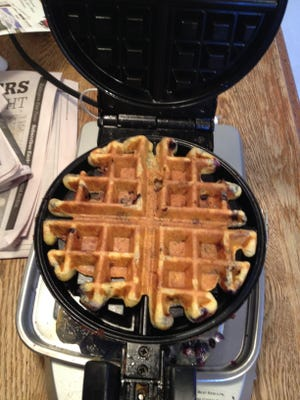 Cornmeal waffles with wild blueberries.