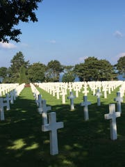 The Normandy American Cemetery and Memorial at Colleville-sur-Mer, France, honors American troops who died in World War II. The 172-acre cemetery saw 9,386 burials and recognized 1,557 missing in action.
