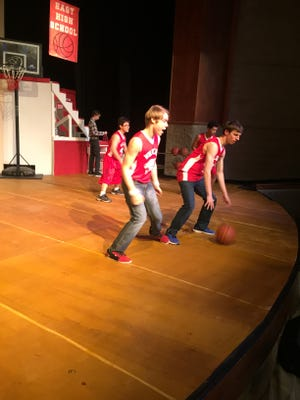 """Mason Buchanan (Chad) and Jason Dernay (Troy Bolton) rehearse one of the dance scenes from """"High School Musical."""""""