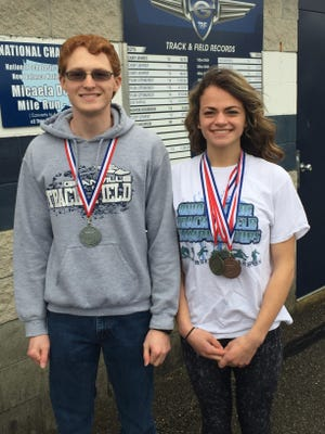 Granville seniors Forrest Lee and Natalie Price display the medals they won last weekend at the indoor state track meet at Akron University. Price won a state title and Lee was state runnerup.