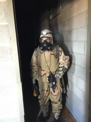 A soldier with the 22nd CBRN Battalion looks for chemical, biological or radiological threats during a training exercise. Soldiers went door to door, room to room looking for threats.