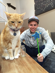 Cam Tucker, right, plans to open Charm Kitty Cafe in