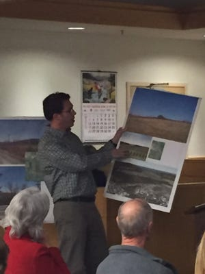 Cliff Scher, developmental director of Distributed Sun, shows a rendering during a Dryden Town Board public hearing on March 16.