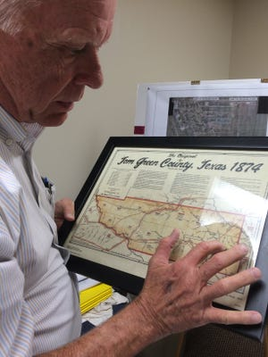 TGC Commissioner Rick Bacon looks at an old Tom Green County map as he discusses floodplain issues.