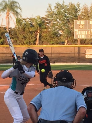 Lely's April Alvarado delivers a pitch to the plate during the first inning of Tuesday night's 9-8 loss to Gulf Coast. The Sharks scored four runs in the top of the seventh to steal one away from the Trojans.