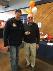 Co-owner Trey Hodge (left) is pictured with his father, AY Hodge (right) at the H&K Outdoor Power store's ribbon cutting ceremony.
