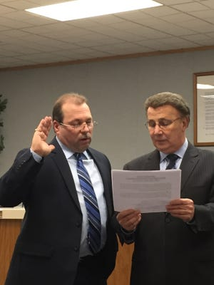 Joe Pagano (left) is sworn in as a member of the Vineland Board of Education on Jan. 8, 2015, as Board Solicitor Bob DeSanto administers the oath of office. Pagano is leaving the position on April 1.