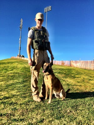 Sgt. Ryan and K-9 Ray, of the New Mexico State University Police Department, at Aggie Memorial Stadium on Nov. 7, 2014. Ray died on March 21, 2017.