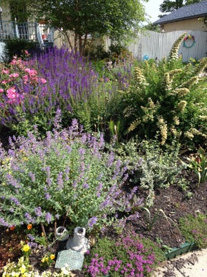Soft colors set the mood for this garden on the 2014 Keyport Garden Walk.