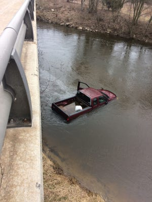 Gasoline floats on the surface of the Sheboygan River by a drowned pickup truck following an incident near Taylor Drive  Wednesday March 29, 2017 in Sheboygan, Wis.
