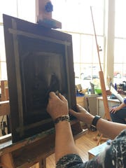 Art instructor Janly Jaggard assists beginning art