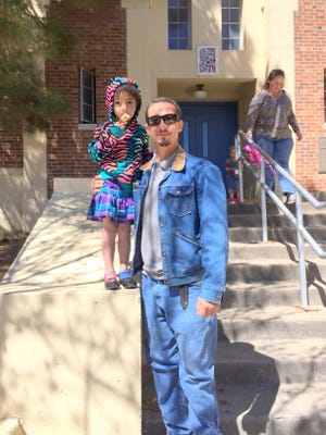 """Gabriel Torrez picks up his four-year old daughter Ralina Muniz from Sixth Street Elementary School on Tuesday afternoon. He stated that she goes to Pre-K at the school and a possible four-day school schedule would interfere with work. """"It would be nice if they would bring in a daycare for those working parents and work around their schedule,"""" Torrez said."""