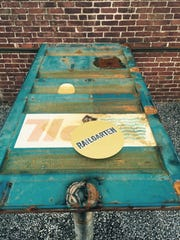 Railcar doors fashioned into tables at Railgarten (2166 Central Ave.).