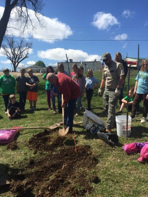 The Forestry Service and the Crooked Creek Conservation Office helped Ms. Thieme's fifth grade science class celebrate Arbor Day.  The Forestry Service provided a Shag Bark Hickory tree, and the Cooked Creek Conservation Office furnished the mulch and helped plant the tree.