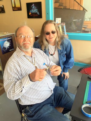 Ken Silagy, and Nina Dillard sit in their shop - Elemental Artisans - Tuesday afternoon and work on a piece of jewelry.