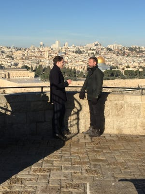 Oxford University geneticist George Busby and Pastor Joe Basile in Israel on the Mount of Olives overlooking Jerusalem, described in the Bible as the place from which Jesus ascended into heaven.