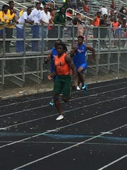 Dunbar's Seneca Milledge sprints away from the pack during his victory in the 100-meter dash Thursday in the Class 2A-District 12 track meet at Lely High School. Milledge won the 100, the long jump and ran a leg on the winning 4x100 relay team, helping Dunbar win the overall team title.